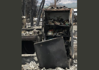 Talent Oregon - Burnt refrigerator with food